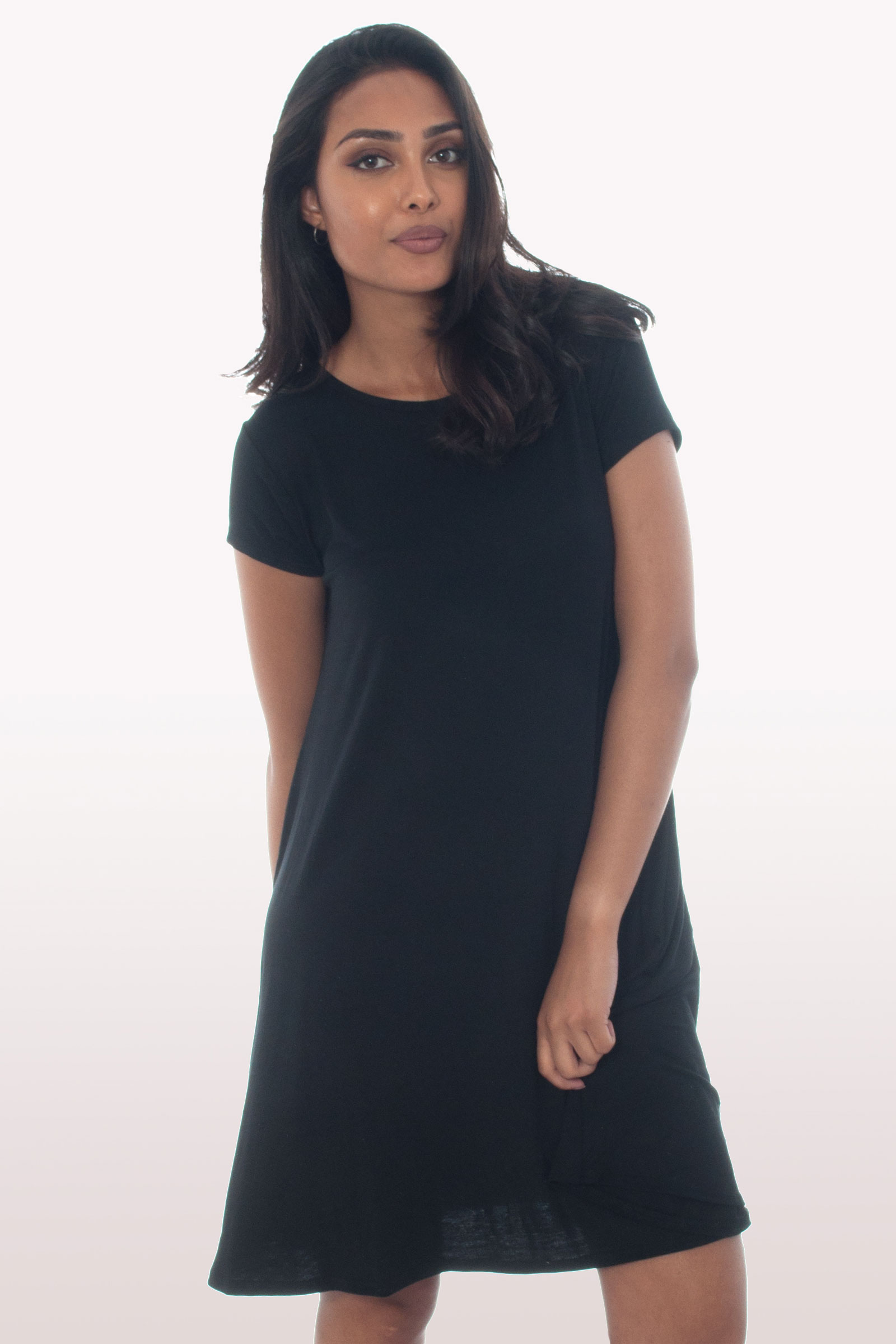 Stay cool and comfortable all day long in women's short-sleeve dresses. Pick luxurious fabrics and cuts for a big night out, a floral print T-shirt dress for your next holiday or a flattering skater dress .
