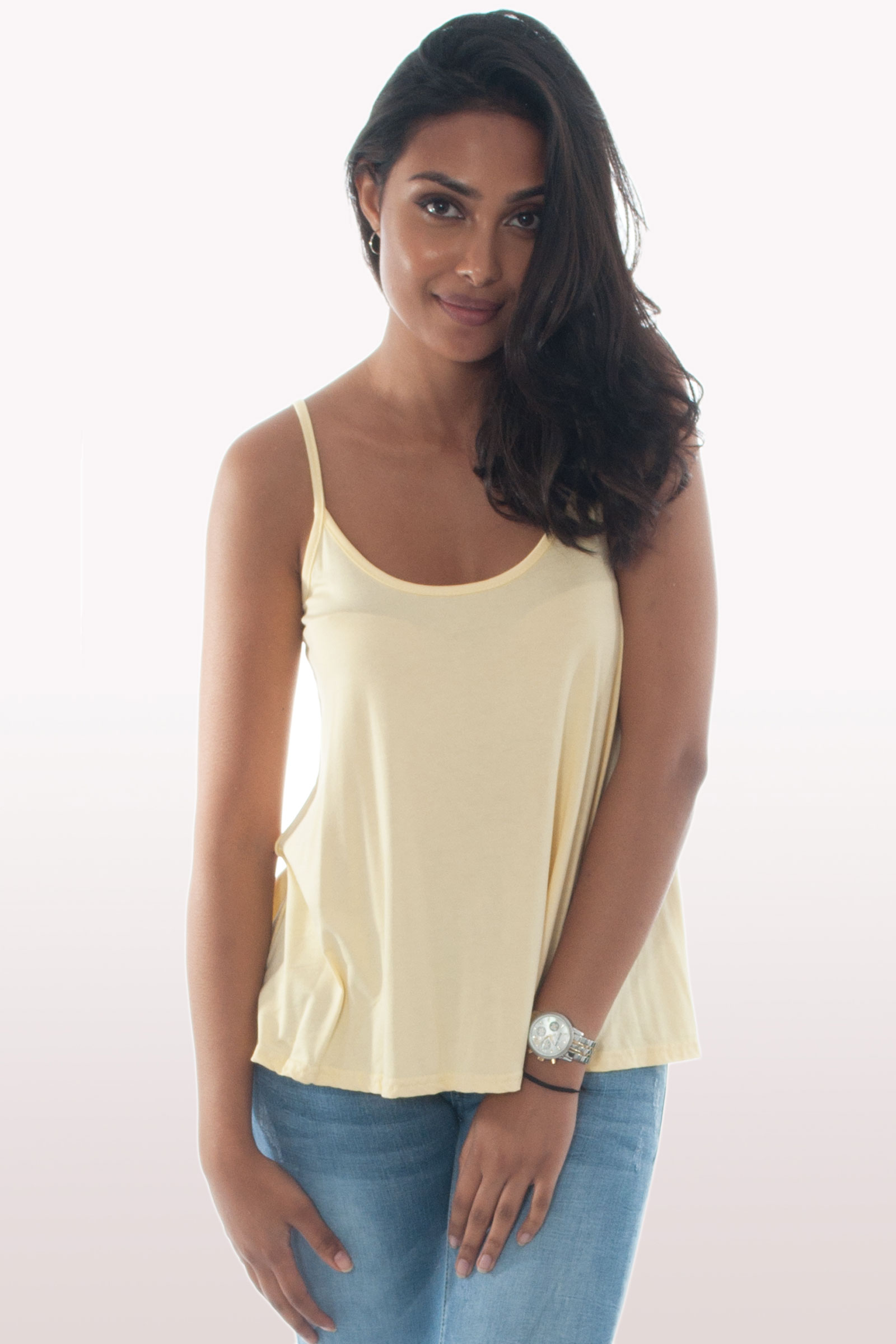 An essential basic for pairing with sheer tops, short shirts, open sweaters, plunging necklines, and warm temps, camisoles offer up comfort, coverage, and function. This Top 10 list brings you options in a spectrum of prices, colors, and cuts.
